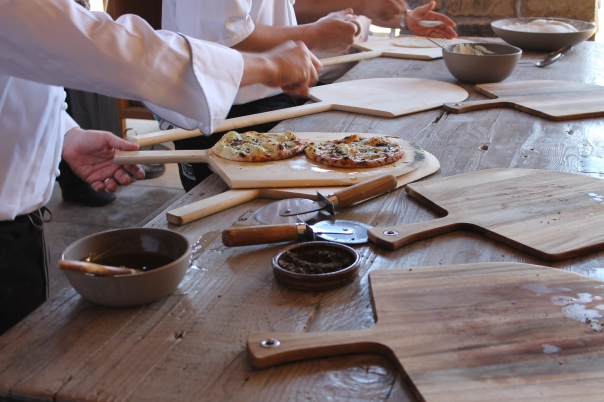 chef Dominic preparing flat bread wood-fired truffled pizza appetizers