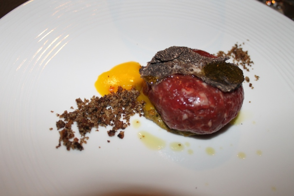 "1st course - beef ""crudo"" with soft yolk and anchovy pesto"