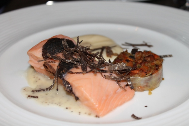 duck fat poached salmon with hedgehog mushroom salad, celery root puree, and black truffle shavings