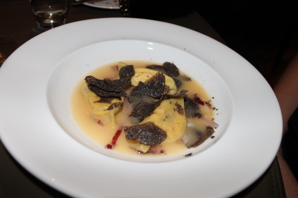 vegetarian 3rd course - ravioli with butter sauce and shaved black truffles