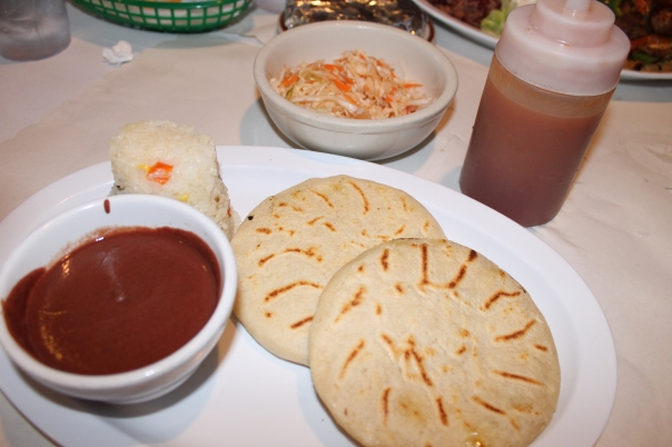 "pupusas with cheese and loroco; sides of rice, beans, and ""crudito"""