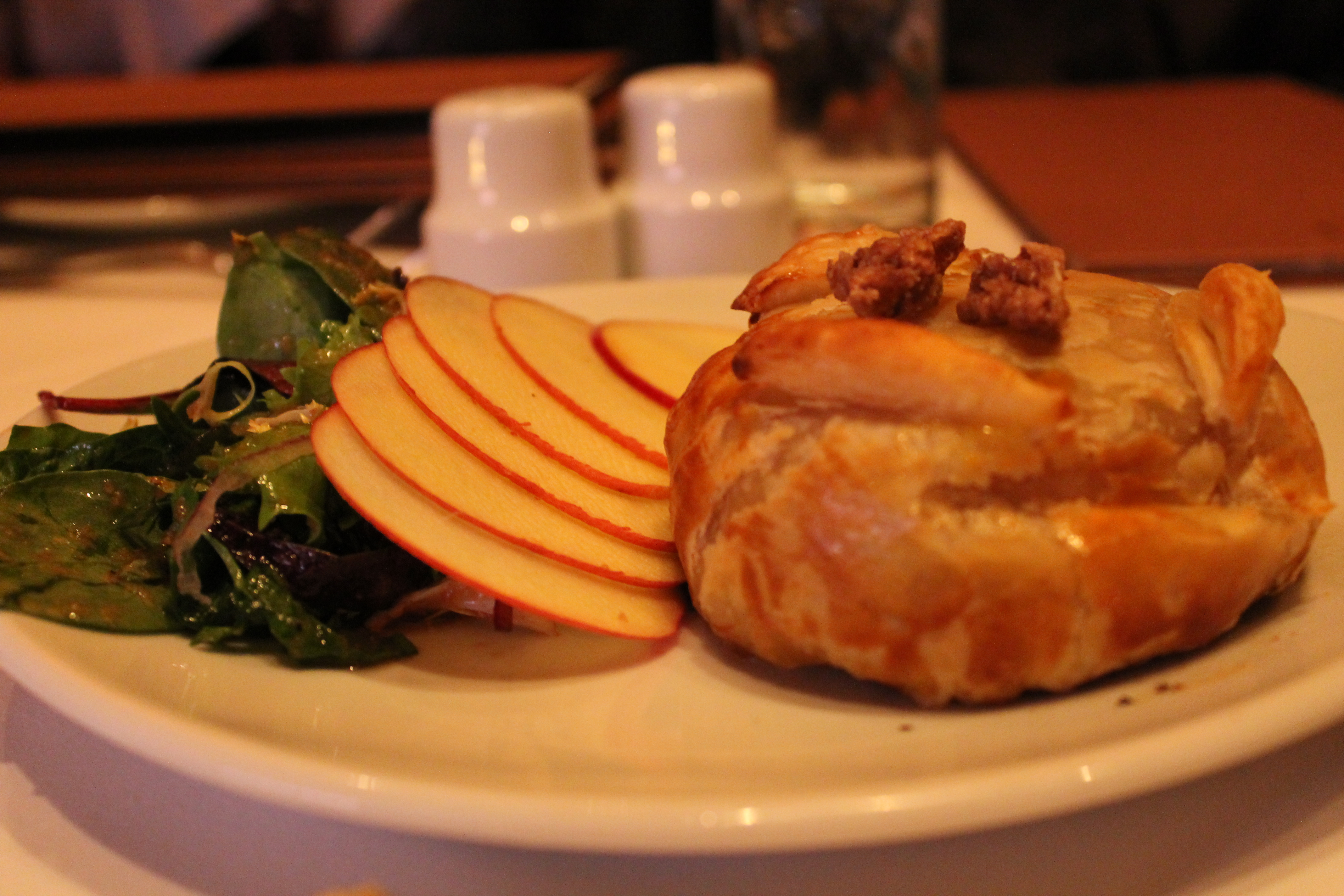 baked brie in puffed pastry with candied walnuts and apples