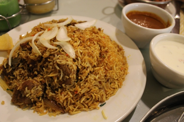 lamb biriyani with curry sauce and raita