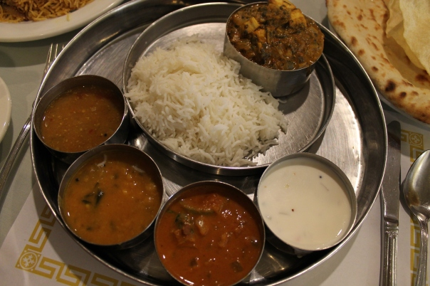 "(sauces L to R): sambar, dal curry, ""vegetable curry of the day,"" and raita"