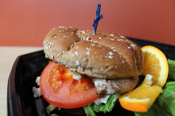 tuna filet sandwich on wheat bun