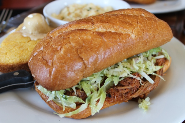 pulled bbq pork sandwich with spicy cabbage slaw