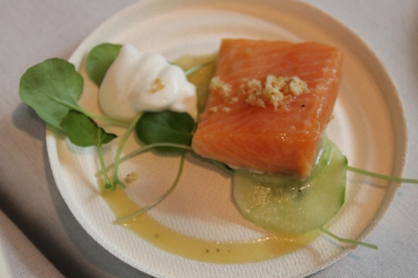 fennel-dill brined and poached iceland arctic char served with horseradish-flavored sour cream, honey-citrus dressing, mustard cress, and almond crumble