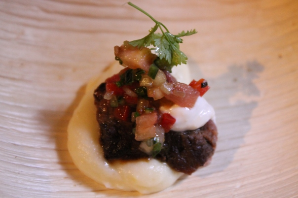 herb-marinated tenderloin of beef with tomato cucumber relish and truffle oil