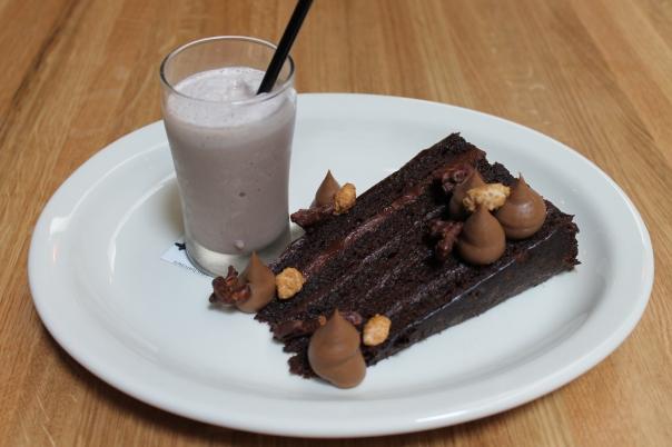 big chocolate layer cake and chocolate malted
