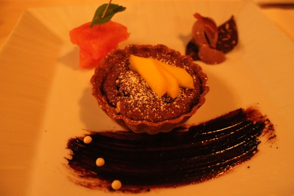 fifth course - freshly baked dark chocolate tartlet