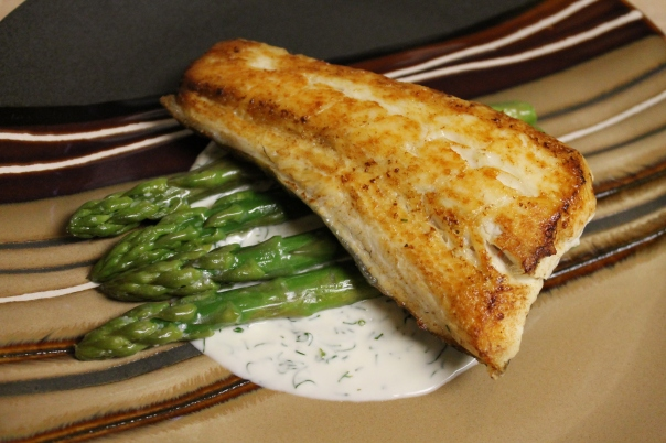 pan-fried halibut with dill cream sauce and asparagus