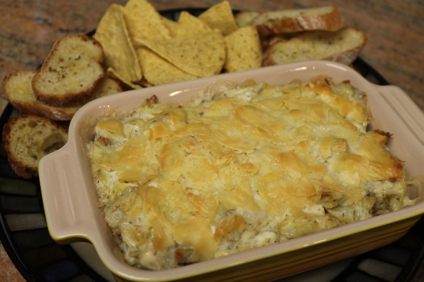 bacon artichoke dip with crostini and truffled chips
