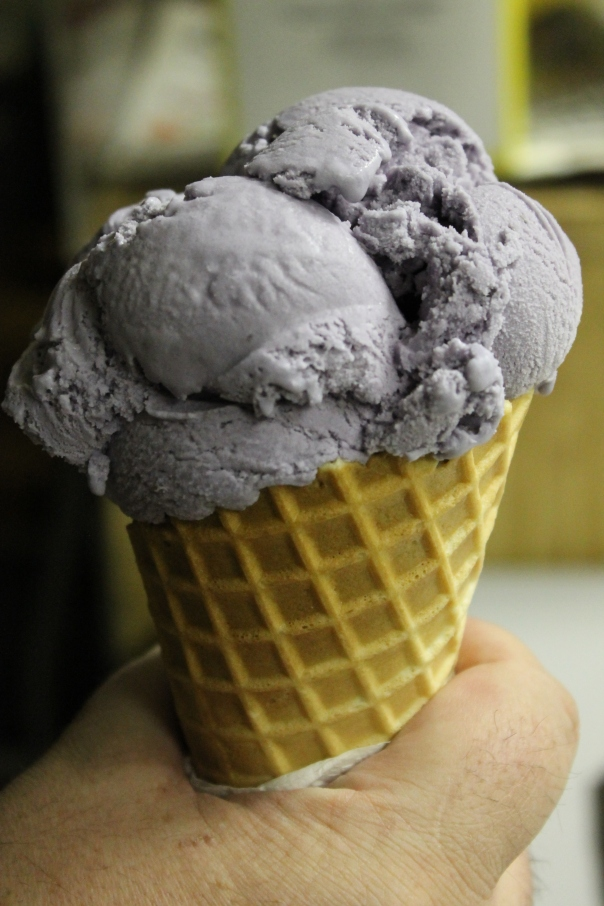 purple yam ice cream in a waffle cone