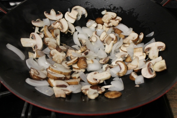 onion and mushroom in the wok